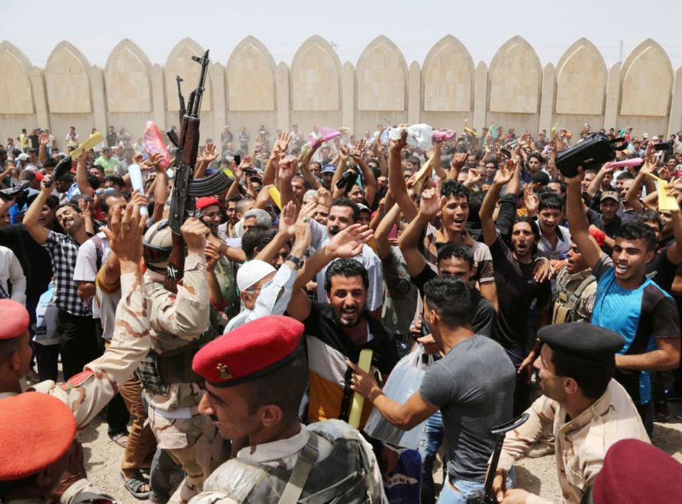 Hundreds of men turned up at an army recruitment centre to volunteer for the military service to protect Baghdad