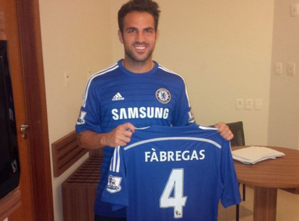 Cesc Fabregas poses with his Chelsea shirt after signing