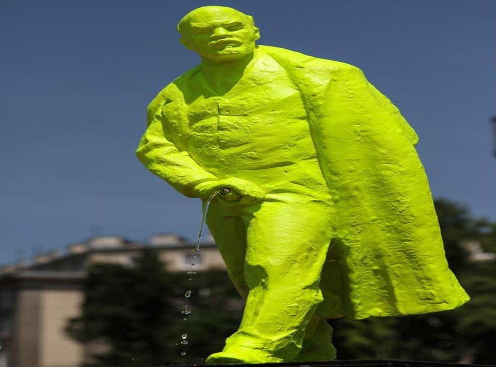 Urinating Lenin statue at the Grolsch Artboom Festival, Cracow, Poland