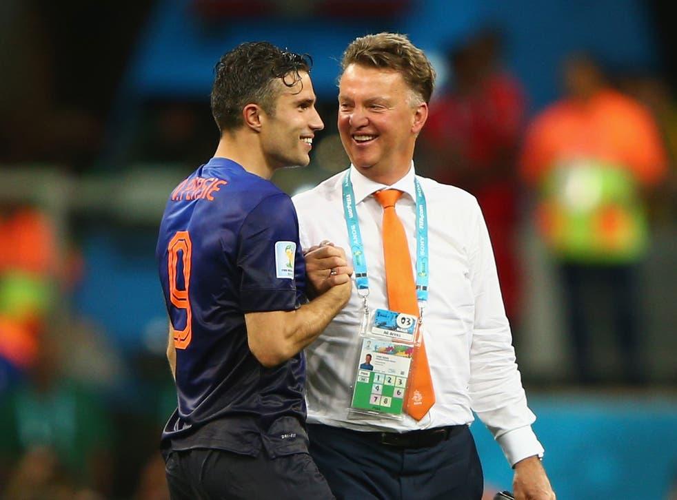 Louis Van Gaal and Robin van Persie celebrate