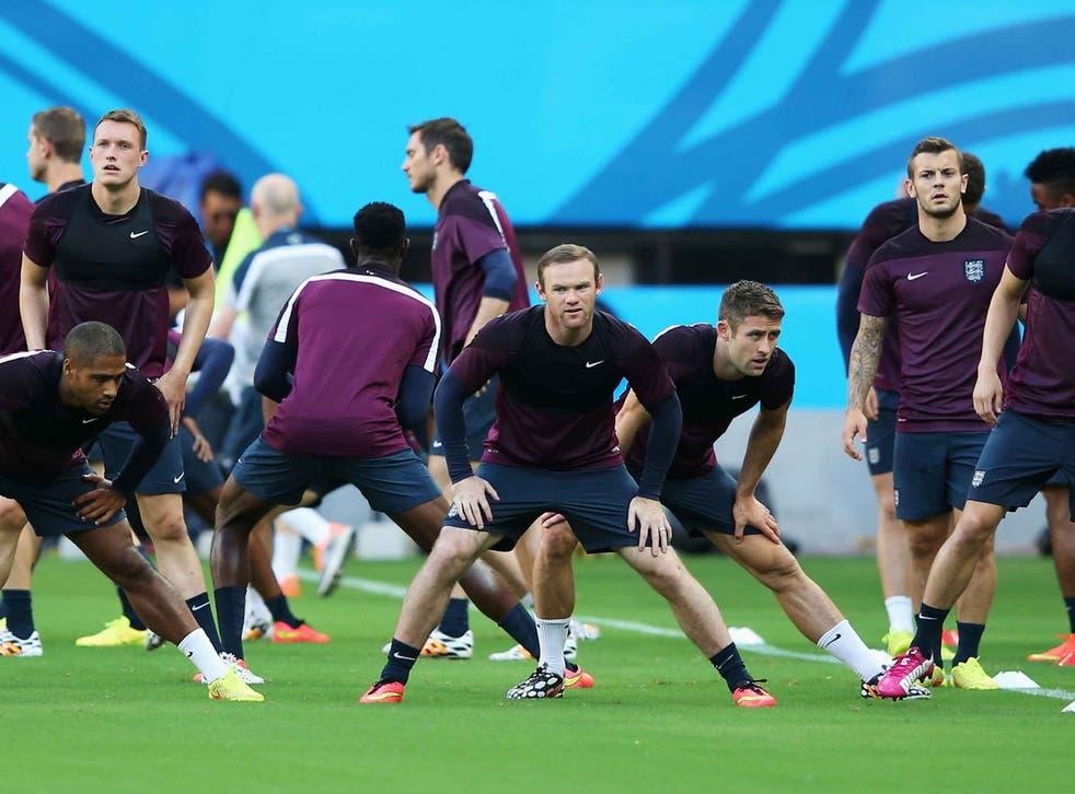 Wayne Rooney stretches with team mates during the England training session ahead of their first match of the 2014 World Cup Brazil against Italy at Arena Amazonia in Manaus, Brazil.