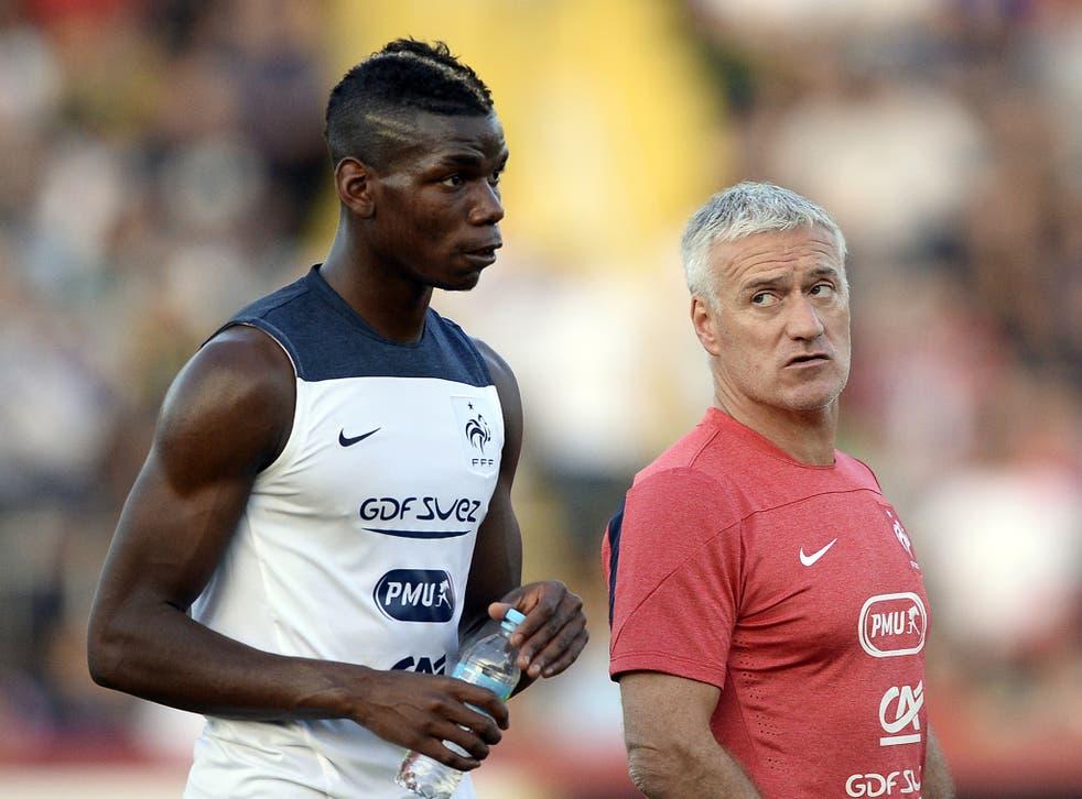 France's coach Didier Deschamps Didier Deschamps (R) talks to France's midfielder Paul Pogba during a training session