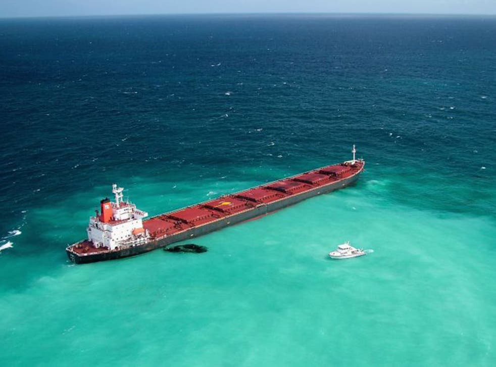 Dirty business: A grounded coal carrier leaks oil on the Great Barrier Reef in 2010