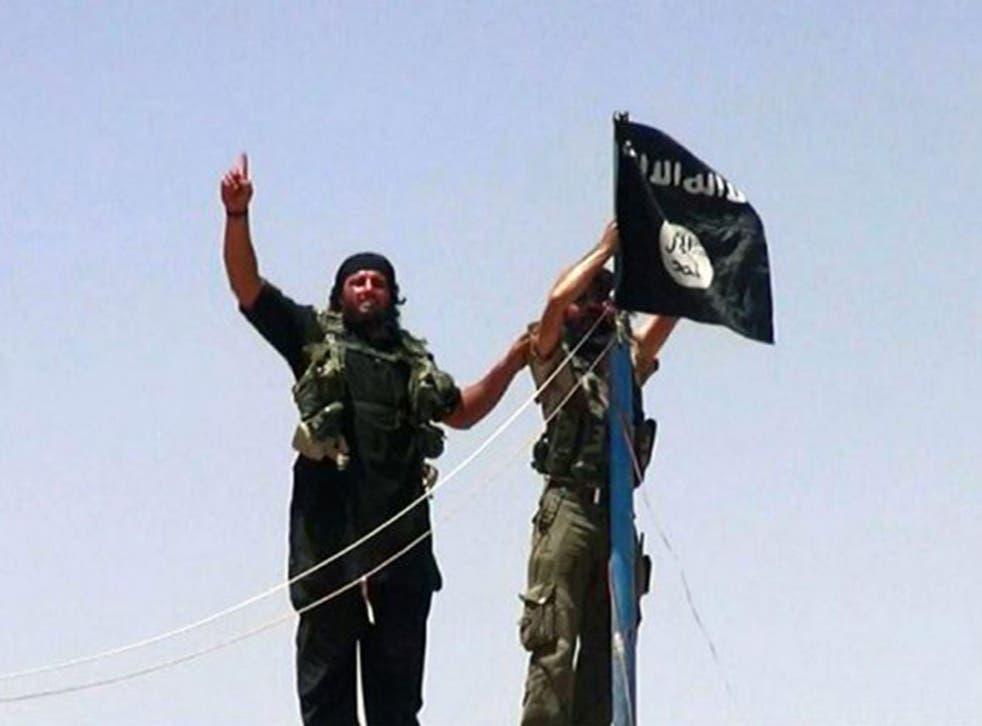 Militants fly the jihadist flag