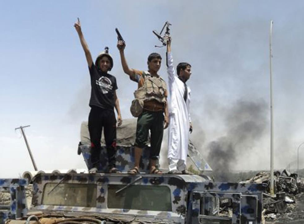 Upheaval: Isis fighters take over an army vehicle