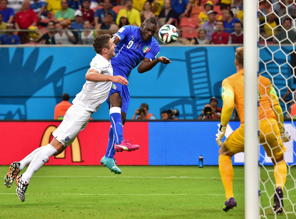 Mario Balotelli heads in Italy's winner against England