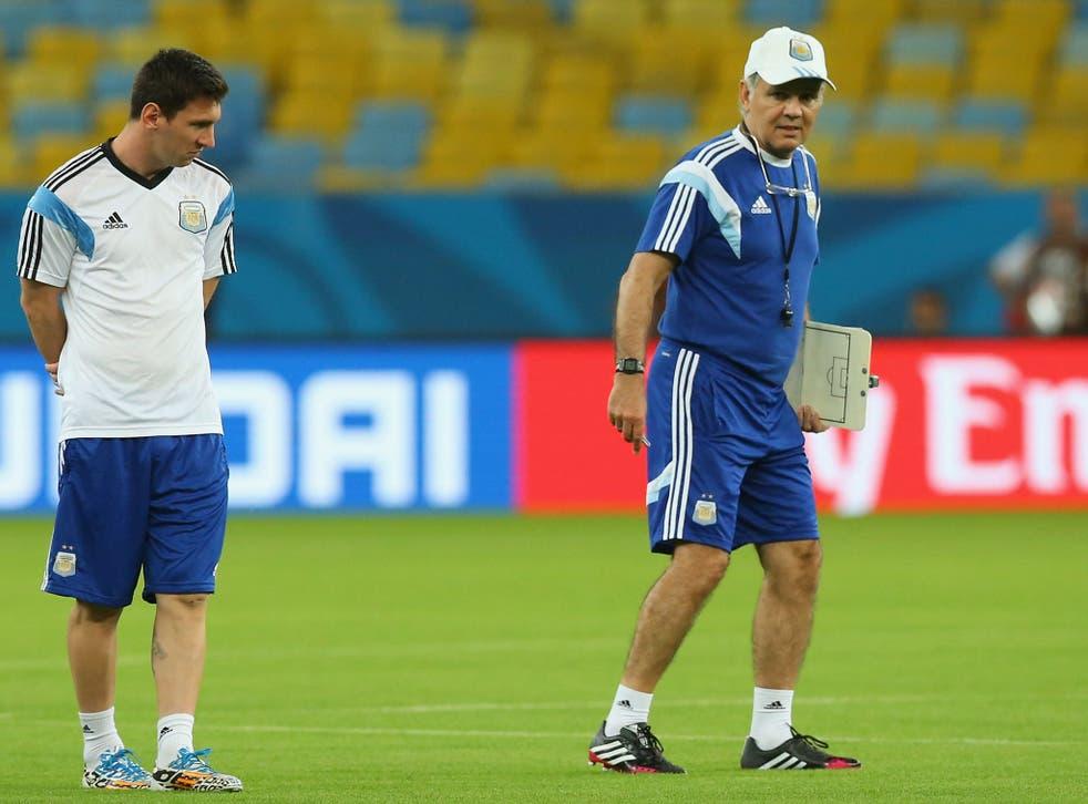 Coach Alejandro Sabella of Argentina and Lionel Messi