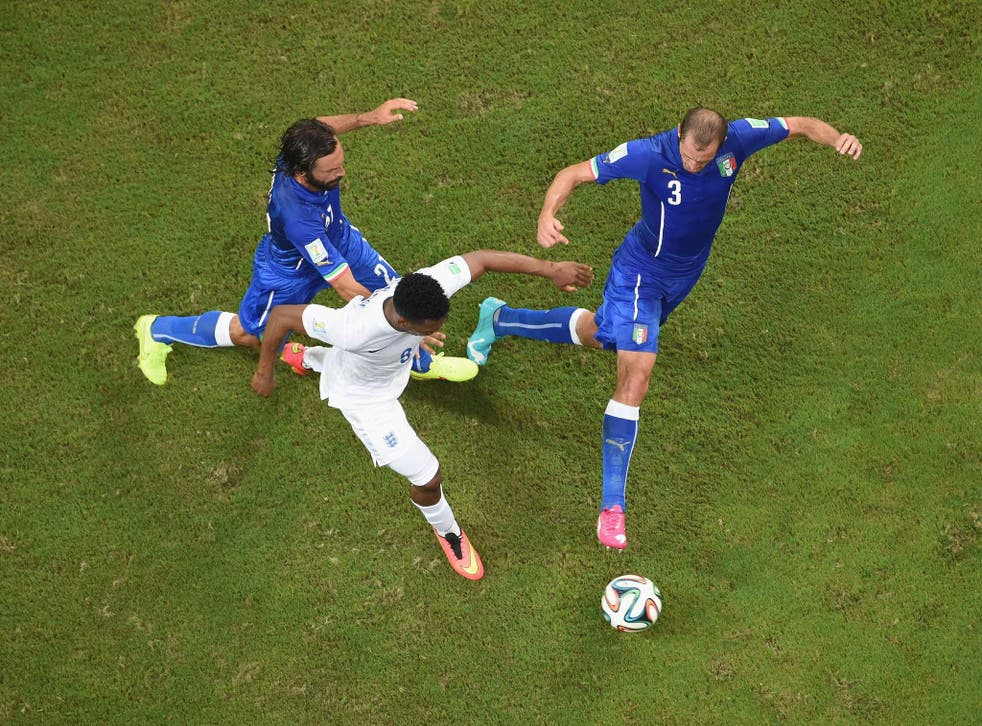 Andrea Pirlo and Giorgio Chiellini of Italy close down Daniel Sturridge of England during the World Cup Brazil Group D match between England and Italy in Manaus, Brazil.