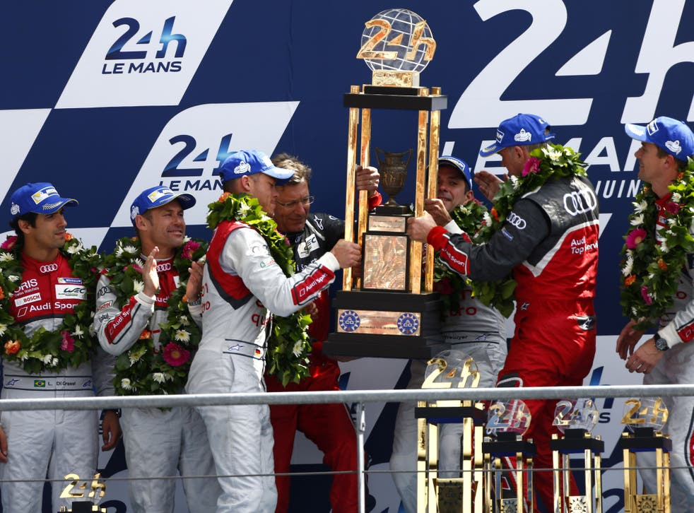 The Audi team celebrate after winning their 13th Le Mans 24 hour title