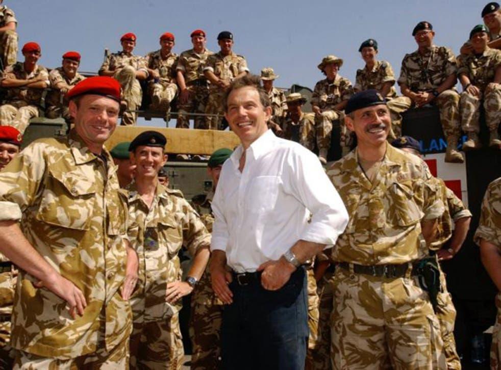 Tony Blair meeting troops in the port of Umm Qasr, Iraq in May, 2003 (PA)