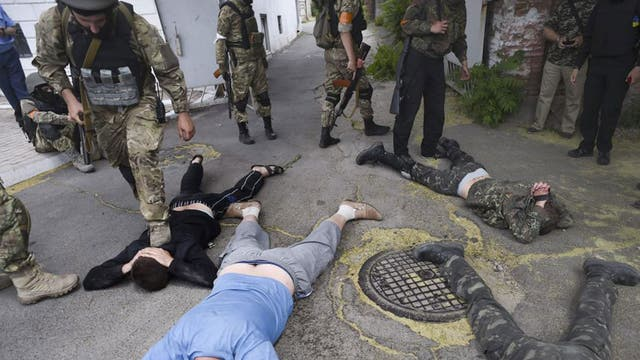 Ukraine 'Azov' batallion soldiers capture pro-Russian activists after taking control over city of Mariupol in Donetsk