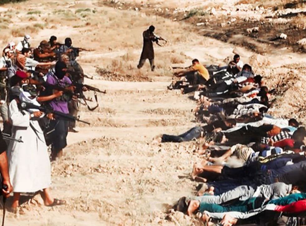 A picture posted on a militant website reportedly shows jihadists from Isis taking aim at captured Iraqi soldiers wearing plain clothes, after taking over a base in Tikrit