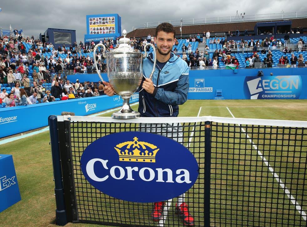 Grigor Dimitrov poses with his Queen's trophy