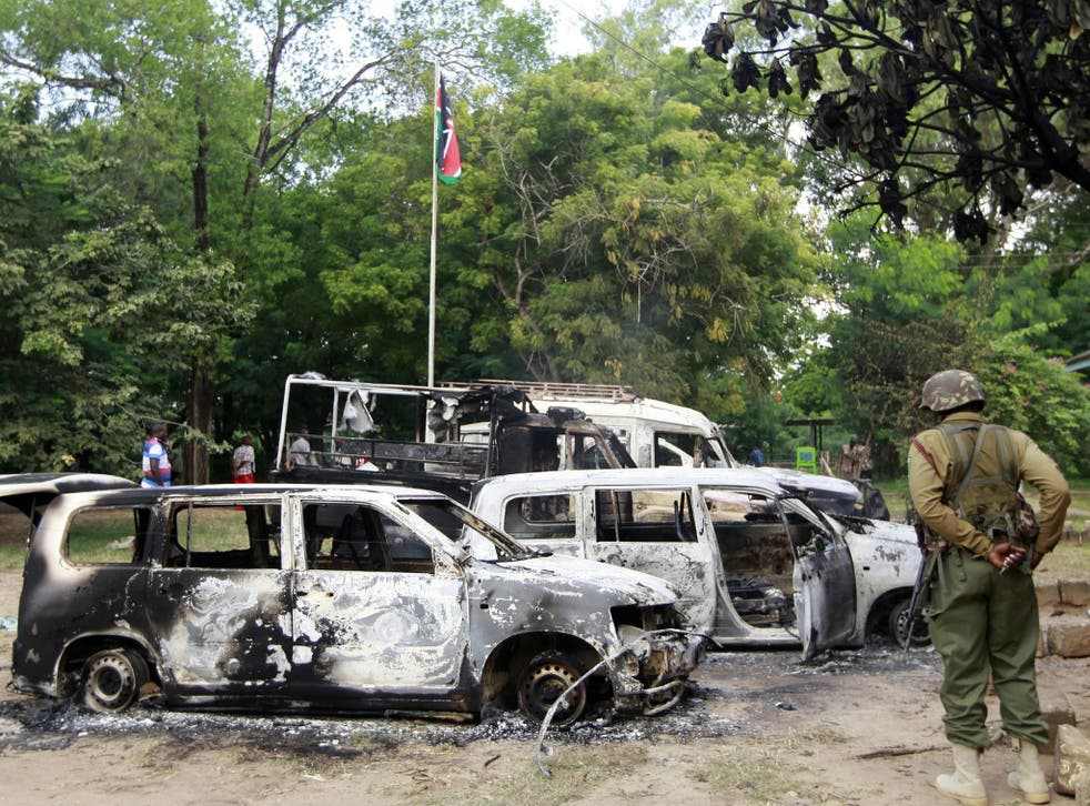 Wreckages of burnt cars are seen outside the Mpeketoni police station after unidentified gunmen attacked the coastal Kenyan town of Mpeketoni