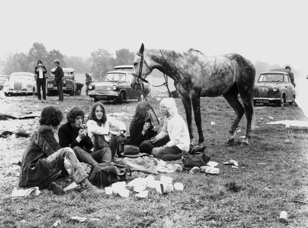 Festival goers enjoy the sunset in a photo to be kept in the V&A's Glastonbury archive