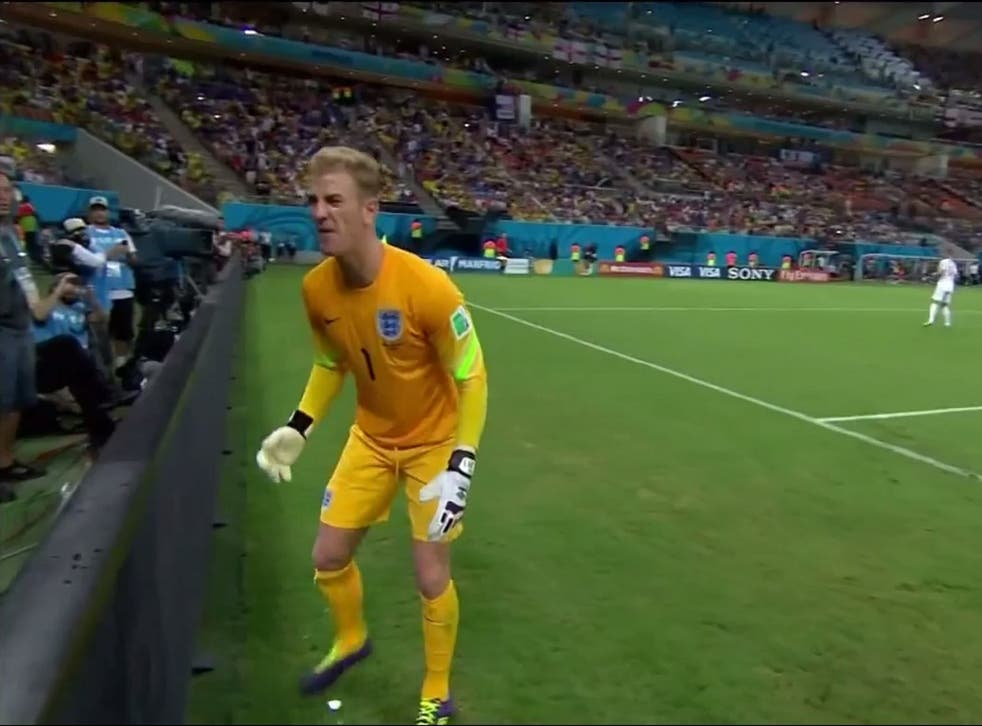 England goalkeeper Joe Hart attempts to retrieve the ball during England's 2-1 defeat to Italy
