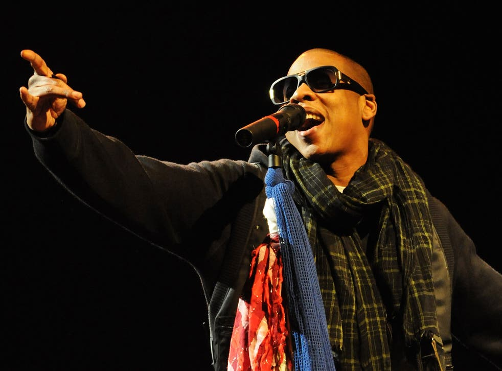Rapper Jay Z performs on the Pyramid Stage at Glastonbury in 2008
