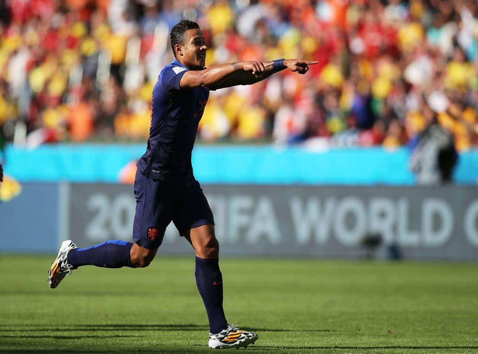 Memphis Depay celebrates after scoring the winner against Australia for Holland