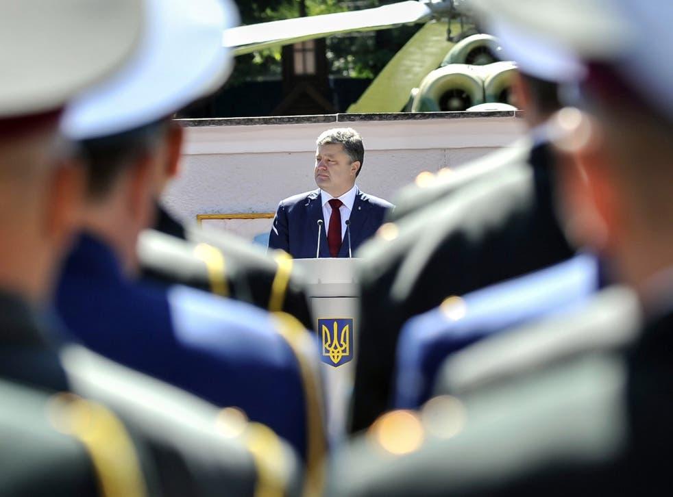 Ukrainian President Petro Poroshenko is trying to strike a peace deal