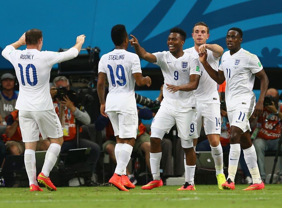 Daniel Sturridge of England (C) celebrates scoring his team's first goal with Wayne Rooney (L), Raheem Sterling (2nd L), Jordan Henderson (2nd R) and Danny Welbeck (R)