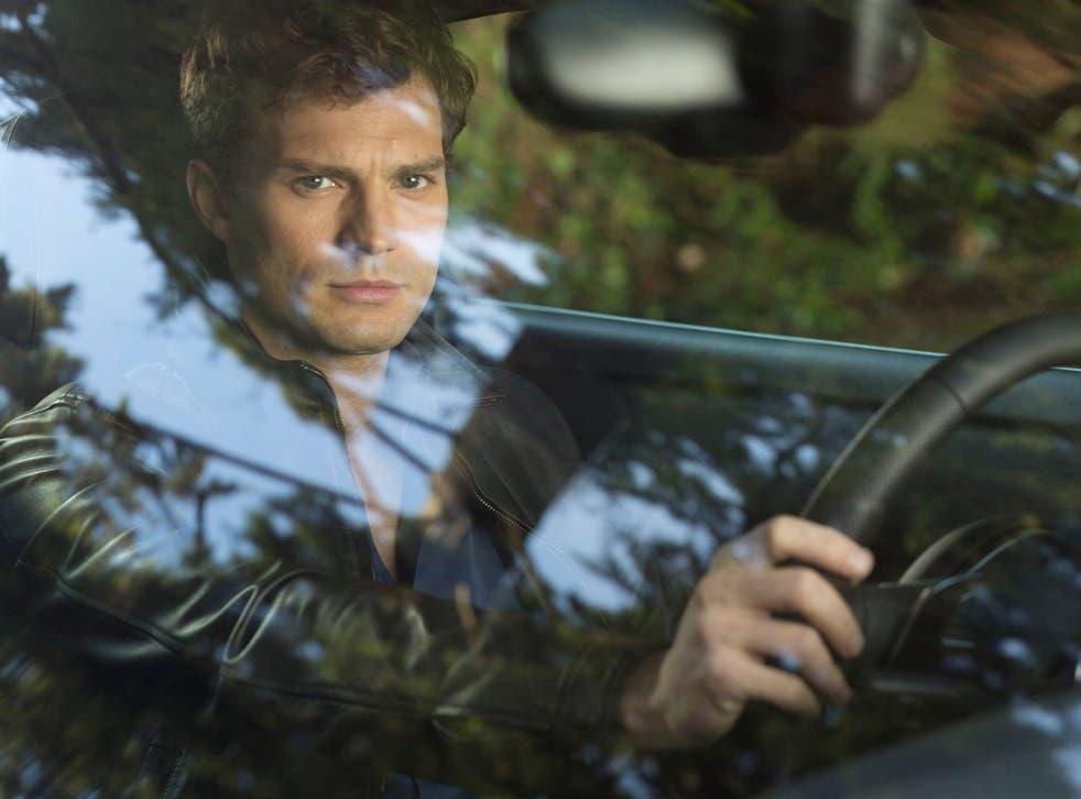 Jamie Dornan as playboy billionaire Christian Grey in Fifty Shades of Grey