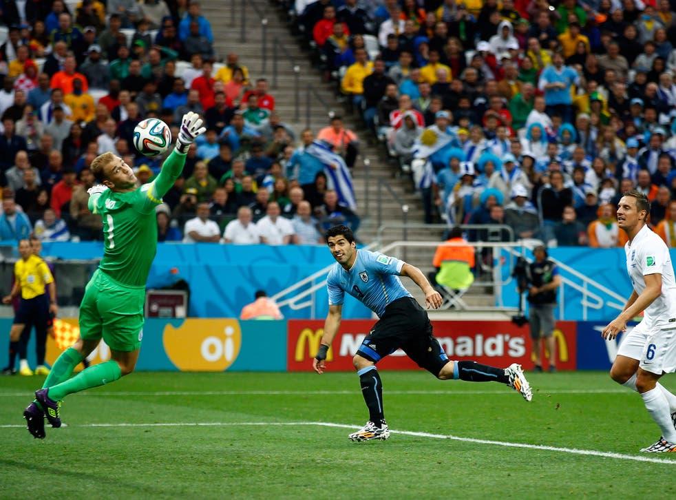 Luis Suarez heads Uruguay ahead