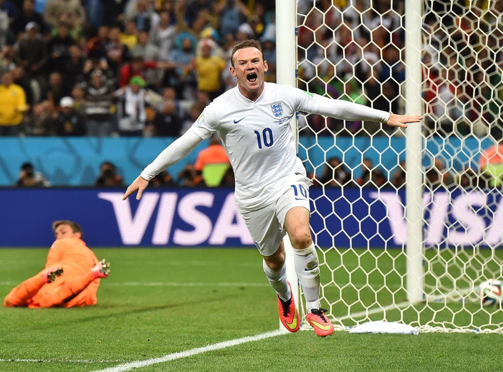Wayne Rooney wheels away in celebration after scoring his first World Cup goal