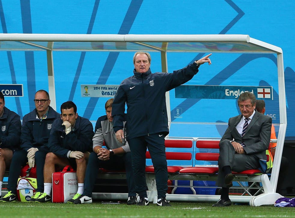 Roy Hodgson sits in the dugout during the Uruguay game