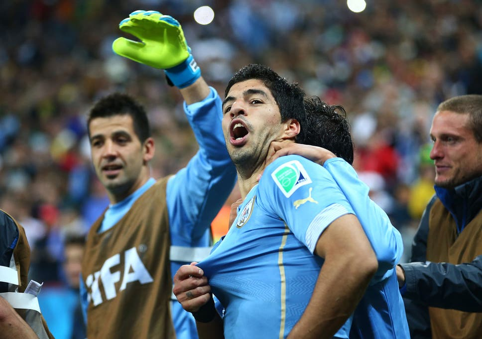 7a4944e454a Luis Suarez of Uruguay celebrates with his teammates after scoring his  team s second goal during the