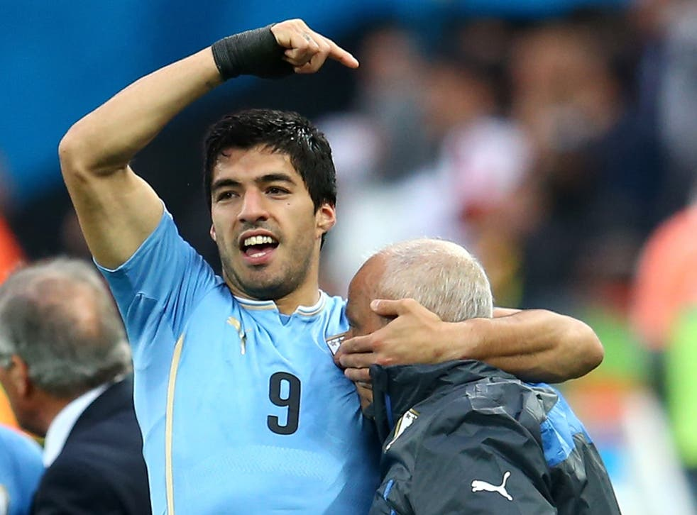 Luis Suarez with doctor Walter Ferreira after Uruguay's 2-1 win over England