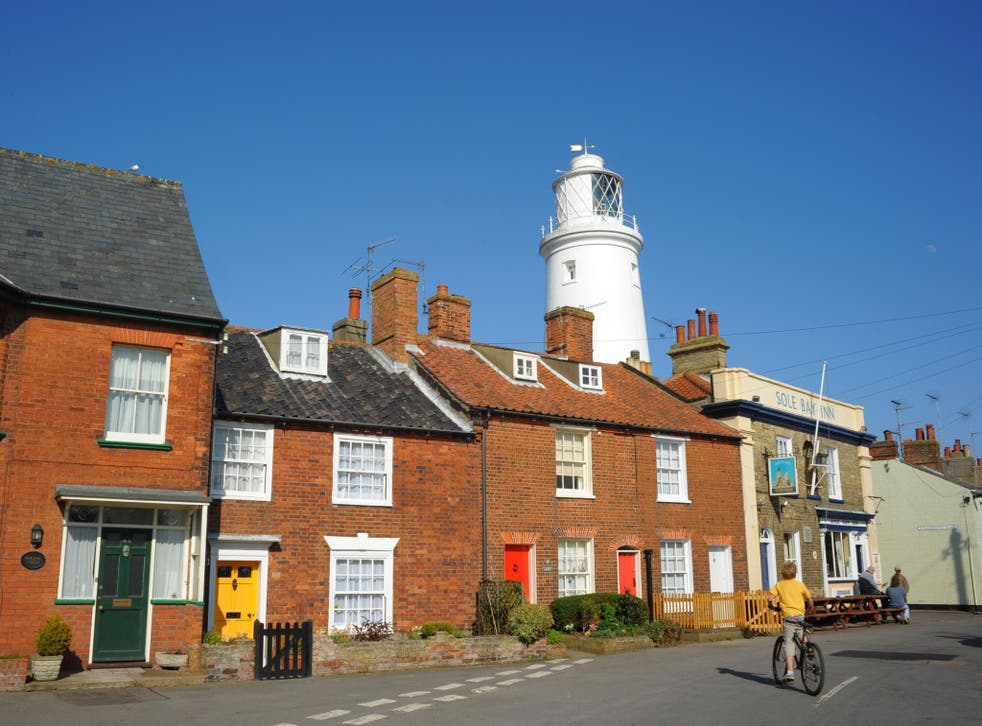 Cottages and the lighthouse in the centre of Southwold, which has been described as 'Kensington-on-sea'