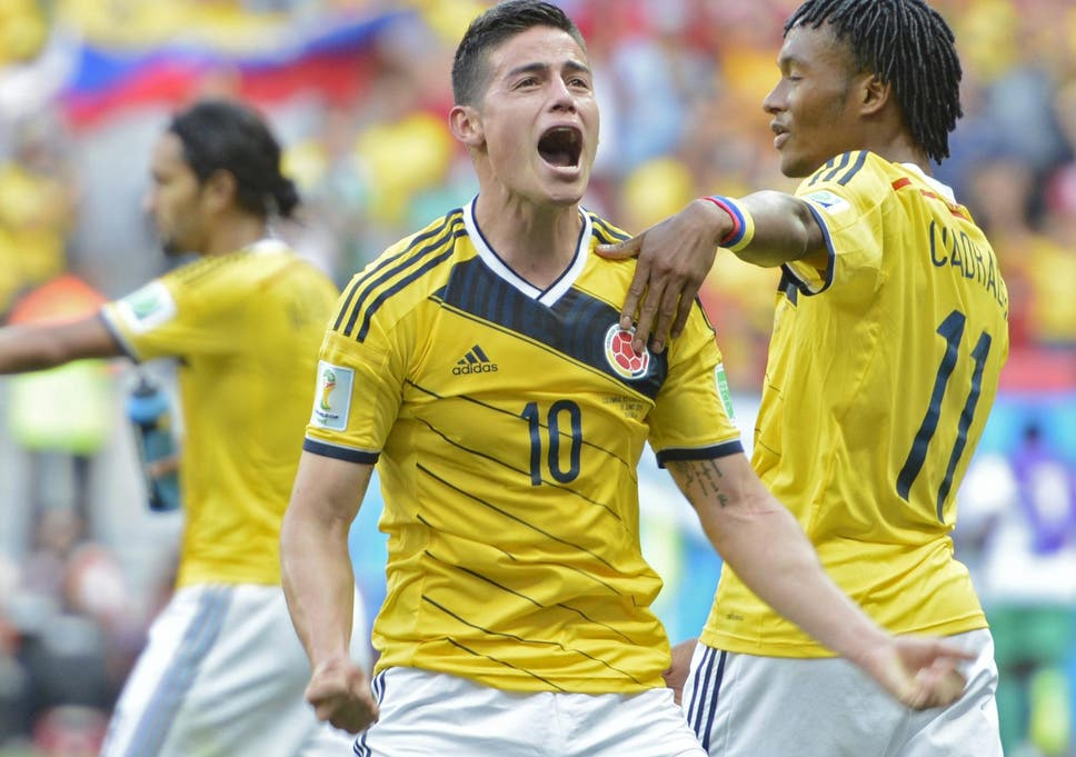 James Rodriguez (centre) celebrates after scoring Colombia s first goal in  their 2-1 bcda349da