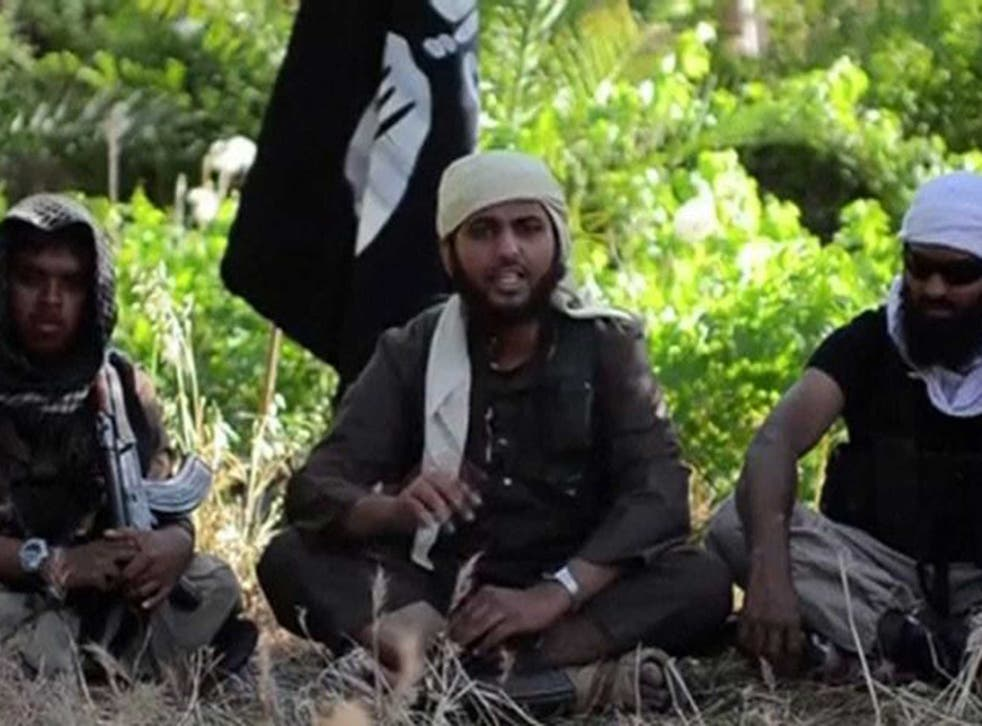 Call to arms: Nasser Muthana (centre), aged 20, from Cardiff, in the Isis recruitment video
