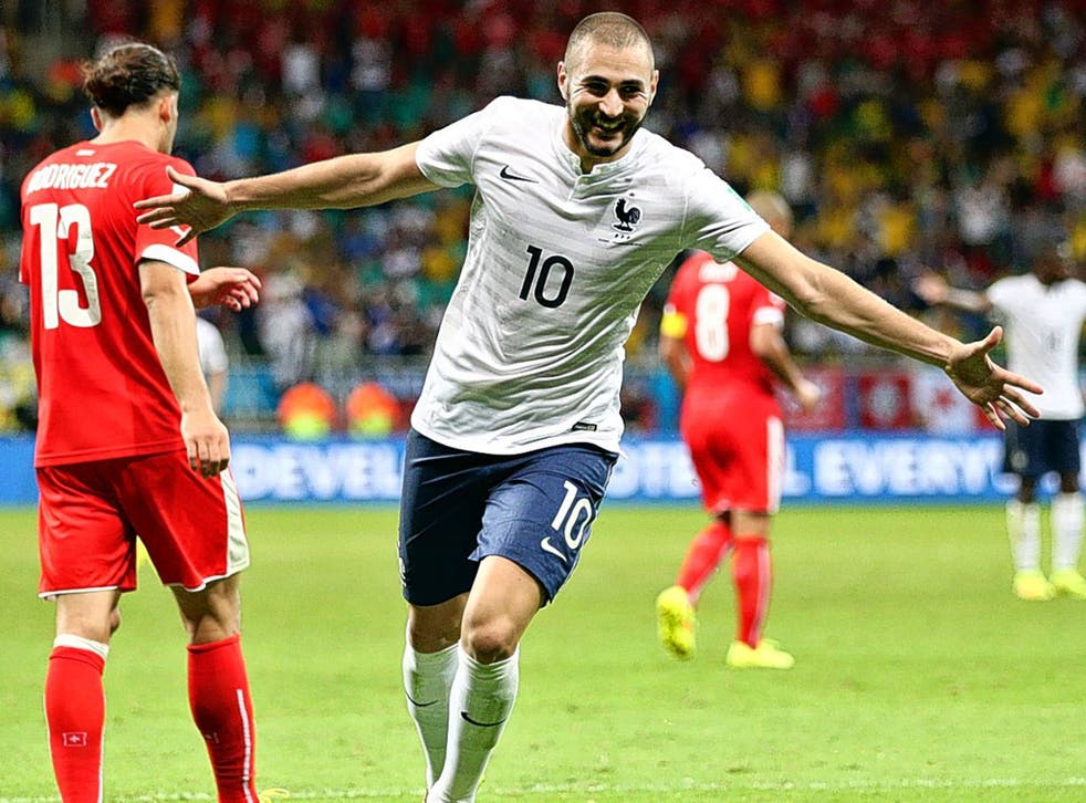 United front: Karim Benzema is enjoying playing with Olivier Giroud under France coach Didier Deschamps
