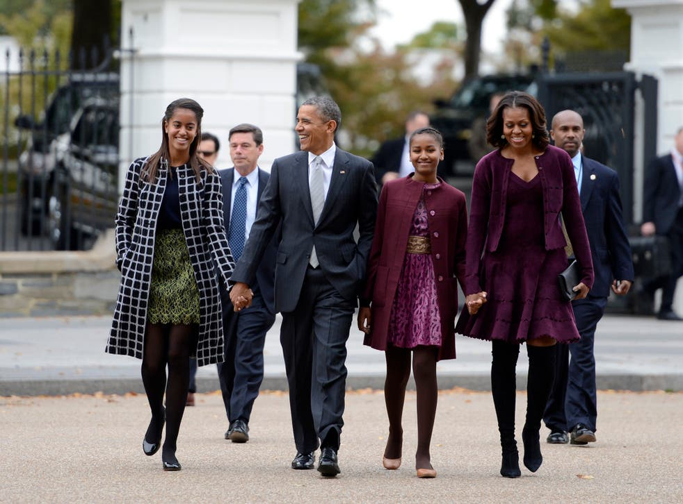 Barack and Michelle Obama with their daughters Malia and Sasha