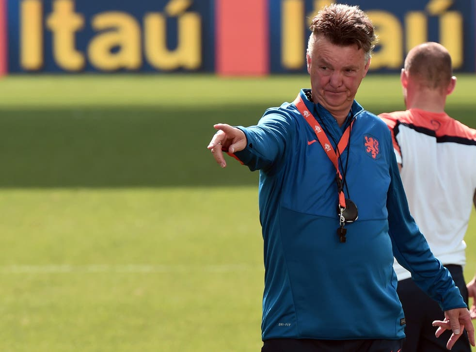 Netherlands manager Louis van Gaal directs traffic