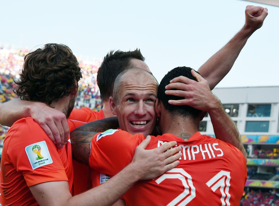 Netherlands celebrate their second goal against Chile