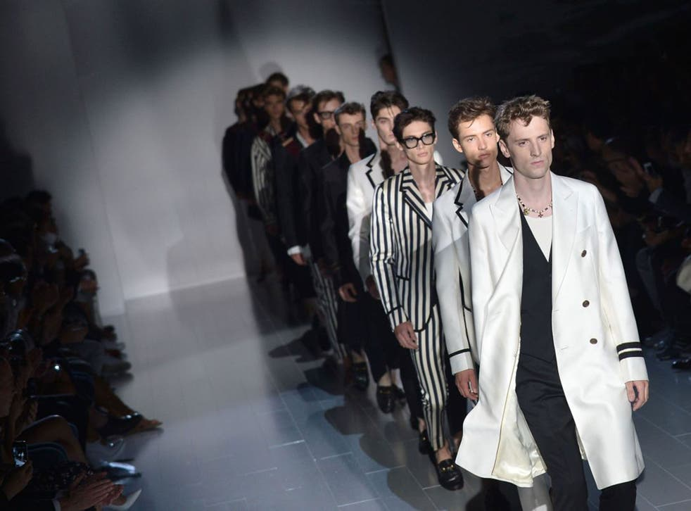 Gucci collection models during men's fashion week display their 'mankles'