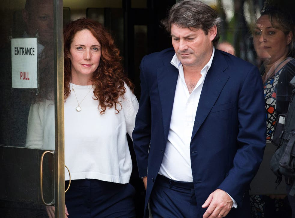 Rebekah Brooks and her husband Charlie leave the Old Bailey this afternoon