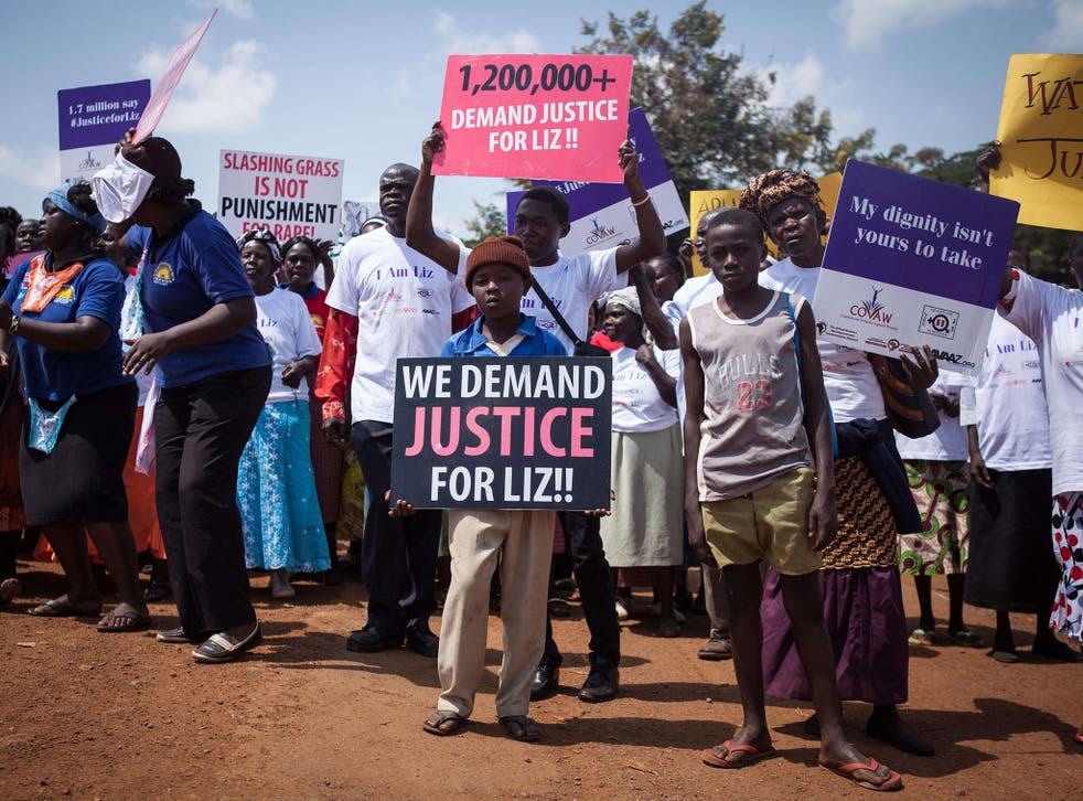 Protesters march through the Kenyan border town of Busia