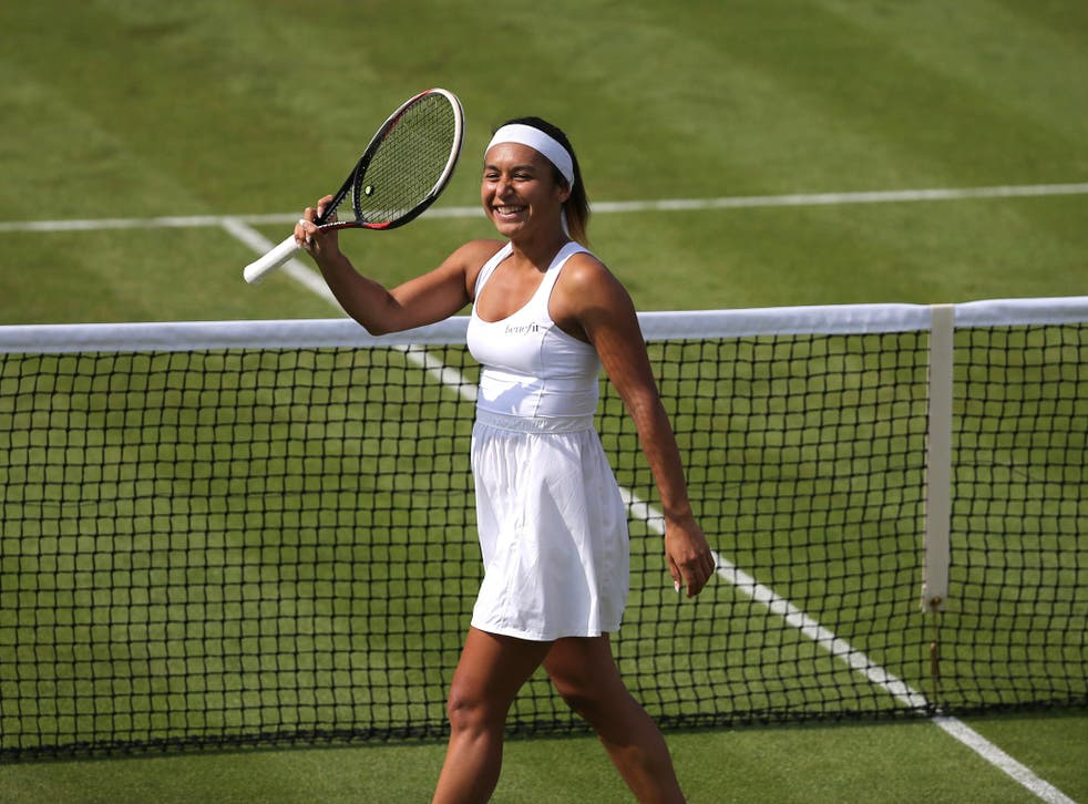 Britain's Heather Watson celebrates after winning her women's singles first round match against Croatia's Ajla Tomljanovic on day two of the 2014 Wimbledon Championships