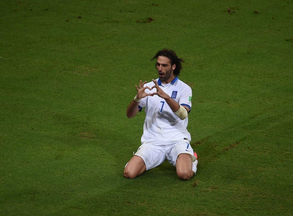 Greece's forward Georgios Samaras celebrates scoring a penalty