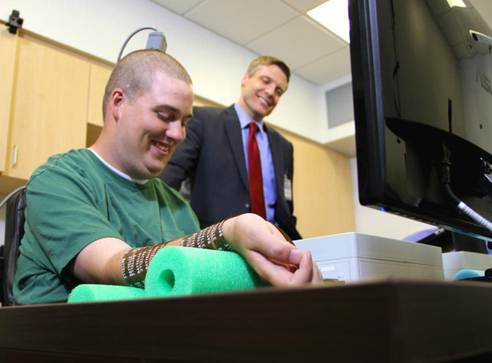Ian Burkhart (left) and Chad Bouton (right), research leader from Battelle. Bouton and his team at Battelle pioneered the Neurobridge technology, working closely with doctors from The Ohio State University Wexner Medical Center, which allowed Burkhart to become the first patient ever to move his paralyzed hand with his own thoughts.