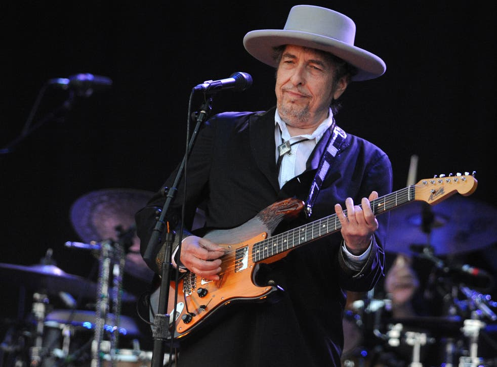Singer songwriter Bob Dylan performs on stage