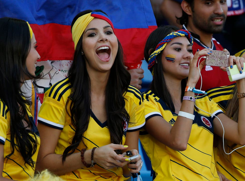 Colombia's fans cheer before the start of their 2014 World Cup Group C soccer match against Japan at the Pantanal arena in Cuiaba June 24, 2014.