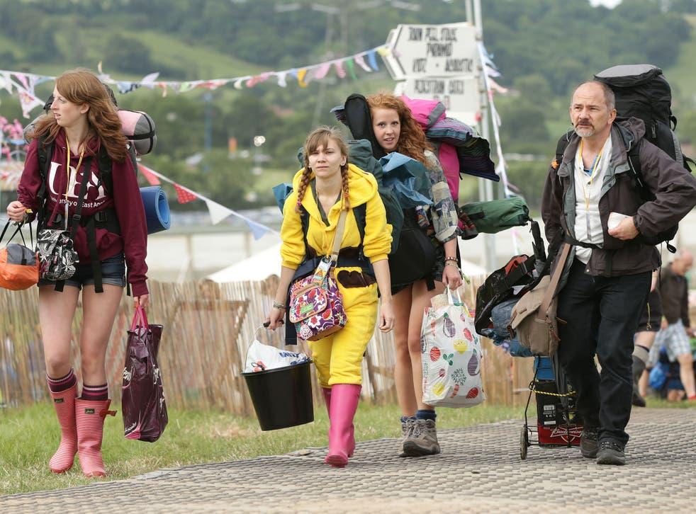 Festival goers arrive for the Glastonbury Festival