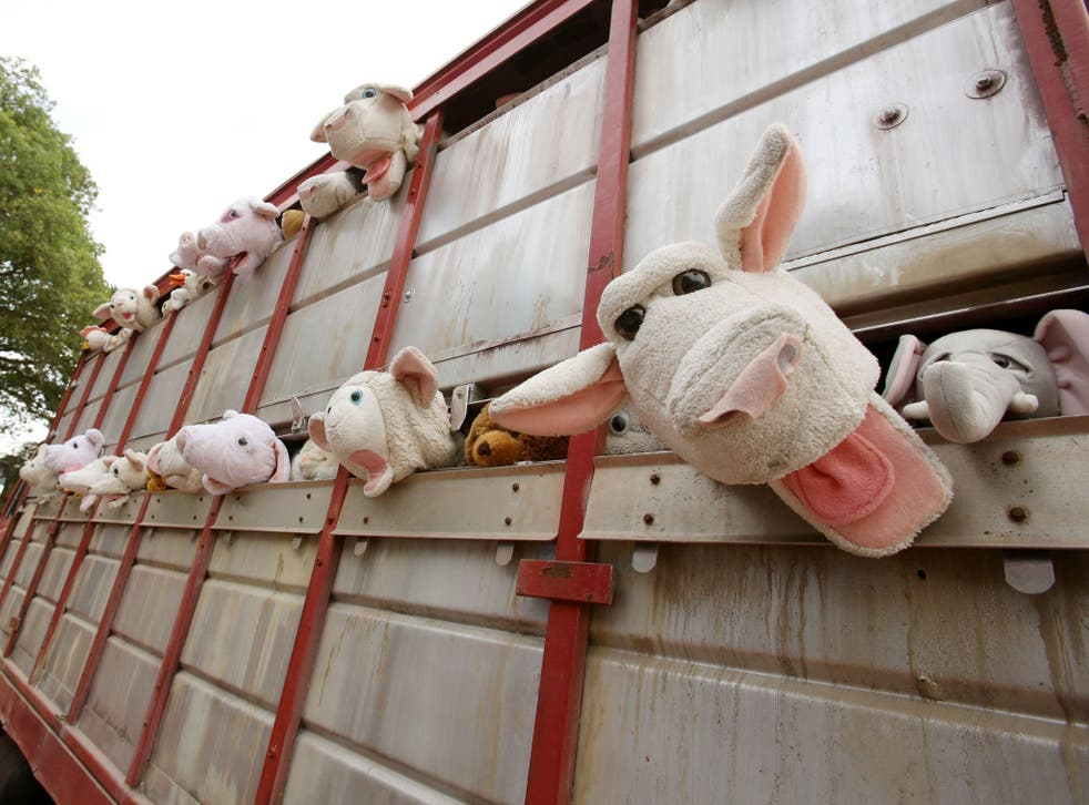 A sculpture by Banksy, entitled 'The Sirens of the Lambs', depicting a truck full of shrieking cuddly animals being driven to slaughter, drives around the Glastonbury Festival, at Worthy Farm in Somerset