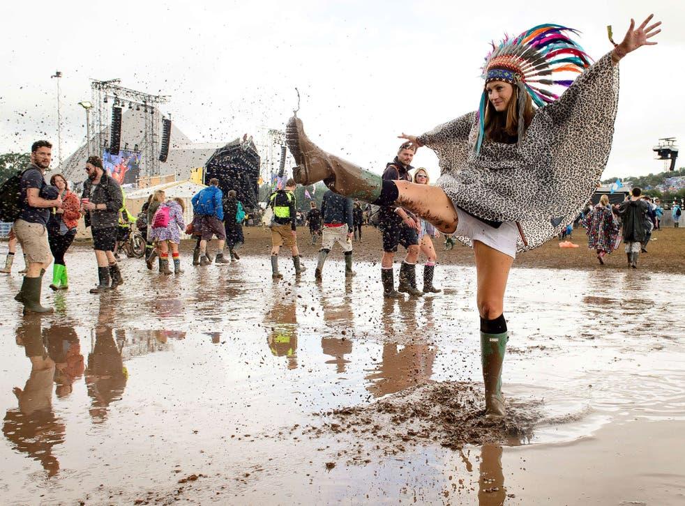 Festival-goers enjoy the mud at Glastonbury Festival