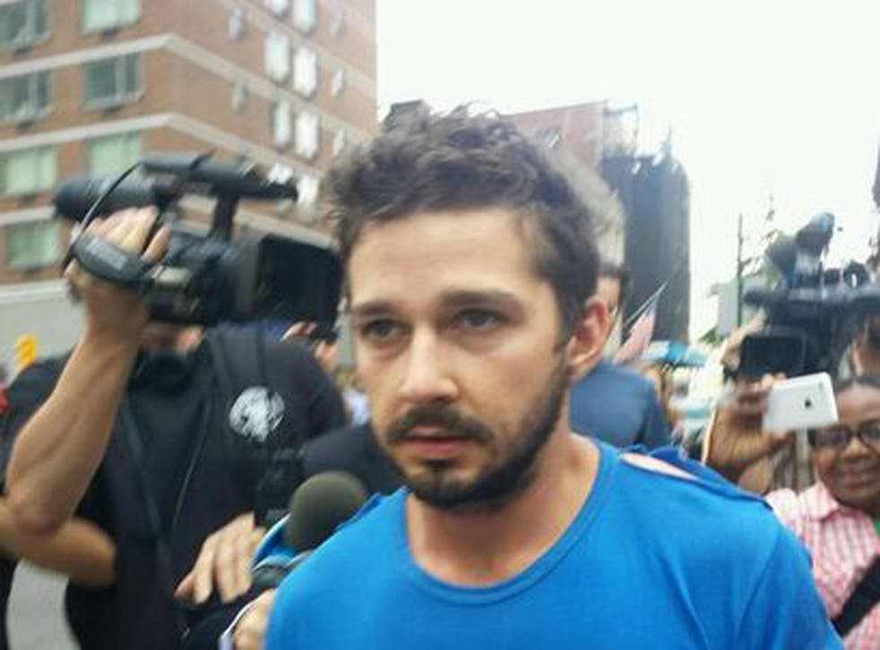 LaBeouf was surrounded by the press as he left a New York police station on Friday