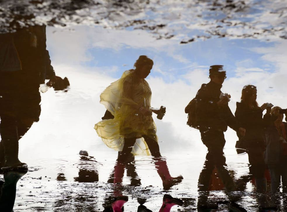 Mucky business: Glastonbury revellers who enduring this year's rain and mud, are part of the middle-class money-making machine  that turned Iggy Pop, John Lydon and Mick Jagger into establishment figures